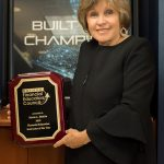 Maria Riofrio with its Financial Education Instructor of the Year award